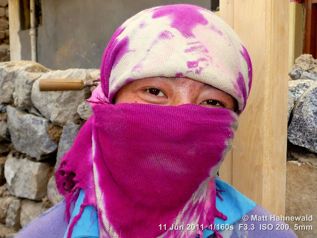 people, street portrait, headshot, face, smiling eyes, face bandana, female construction worker, India, Ladakh, Leh, eye contact