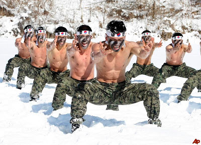 japenese men working out in snow