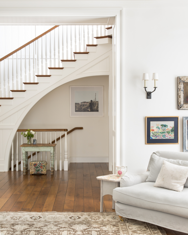 Staircase and walnut hardwood floors in traditional home by Giannetti Home