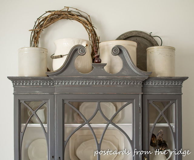 Painted China Cabinet with Vintage Crocks on top. Lots of great decorating ideas on this site. Postcards from the Ridge