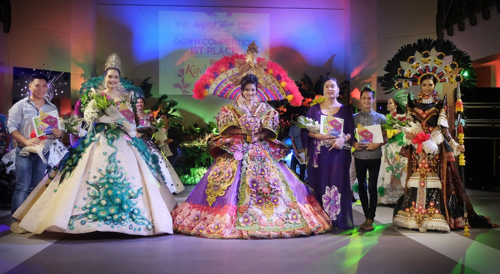 The Top 3 winners in the Gown Competition 1st Place - Kadayawan by Geronie Labora, 2nd Place - Binatbatan Festival by Federico Navarro, and 3rd Place - Ati-atihan Festival by Nicole Salih Festival de las Bellas y Flores Gown Competition National Costume