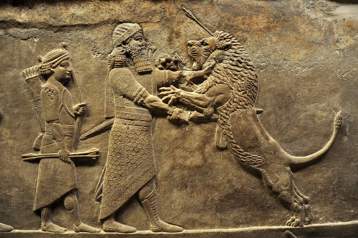 Asurbanipal matando un león (de la cacería de Asurbanipal).