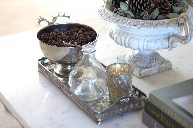 styling a coffee table antique urn pinecones silver tray fall christmas