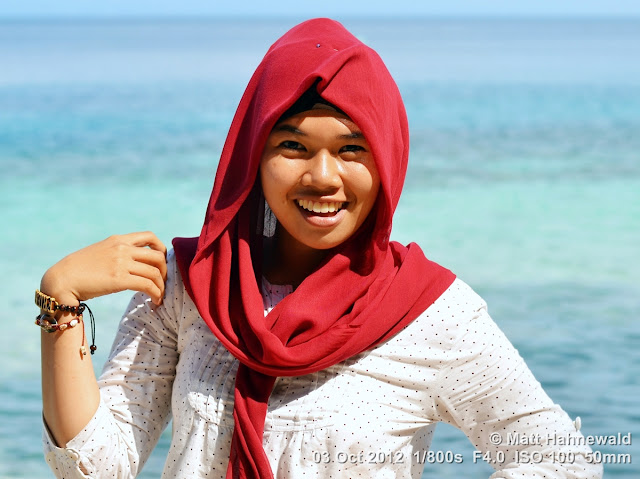 street portrait, Indonesia, Central Sulawesi, young Indonesian Muslim lady, maroon hijab, beach, beauty, charming, outgoing, smiling, posing