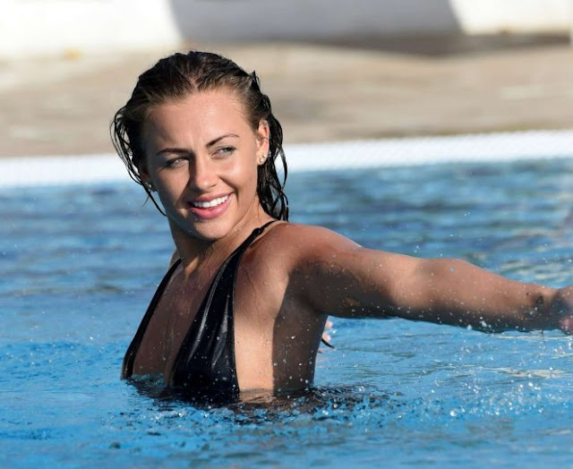 Ashleigh Defty in Black Swimsuit at a pool in Tenerife
