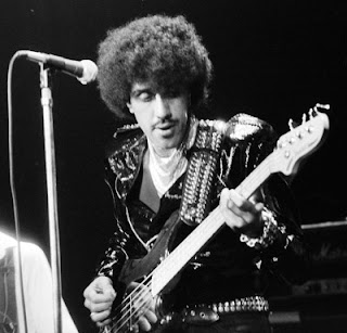 Phil Lynott, Thin Lizzy playing live on stage, 1980