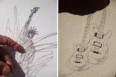 Estatua de la libertad y una guitarra.