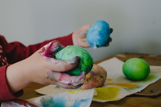 Child's hands holding painted Easter eggs