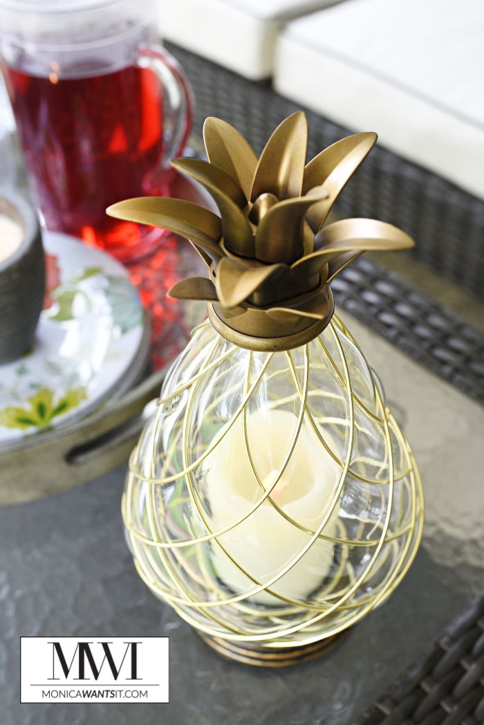 A flameless LED pineapple candle makes a chic addition to any outdoor or indoor table.