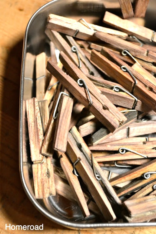 container of wooden clothespins aged with vinegar