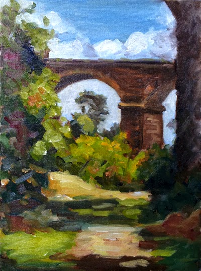Oil painting of an arched bluestone rail bridge and light dappled pathway viewed from a shady spot amongst trees.
