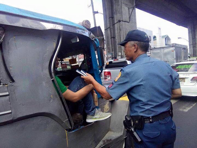 Cops hand out free Bible to motorists and commuters.