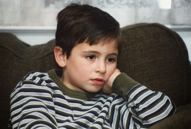 Boy watching TV for lack of internet in the past