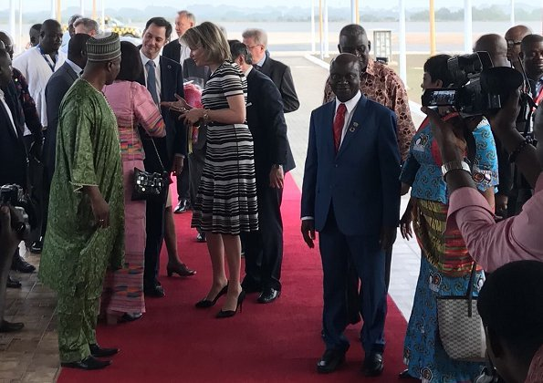 Queen Mathilde wore Natan floral print dress, Natan shoes an carried Natan clutch for visit Televic e-lab, SDGs and Unicorne Siona in Ghana