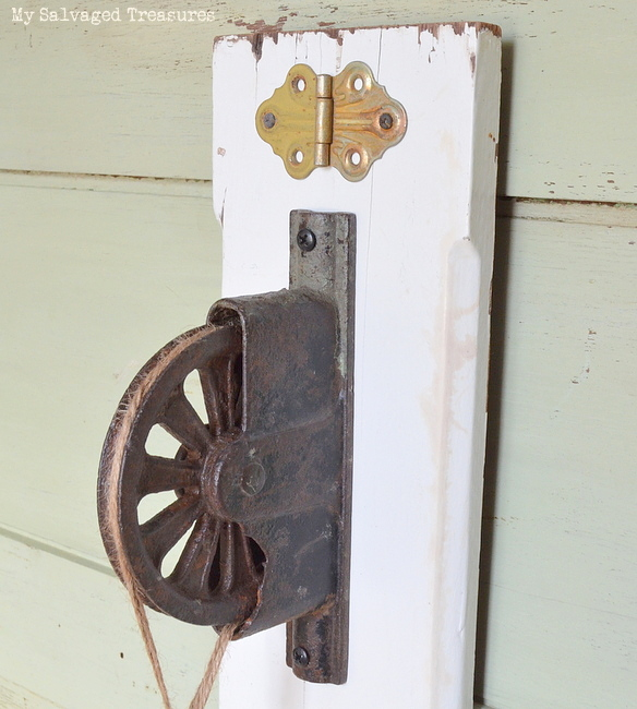 add a rusty pulley to scrap wood