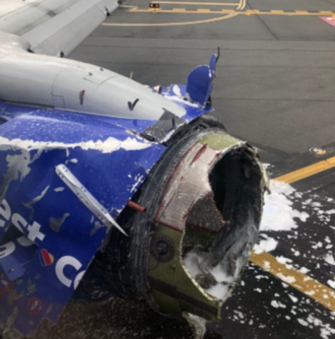 One dead, woman almost sucked out of a plane window after engine exploded at 32,000ft (Photos)