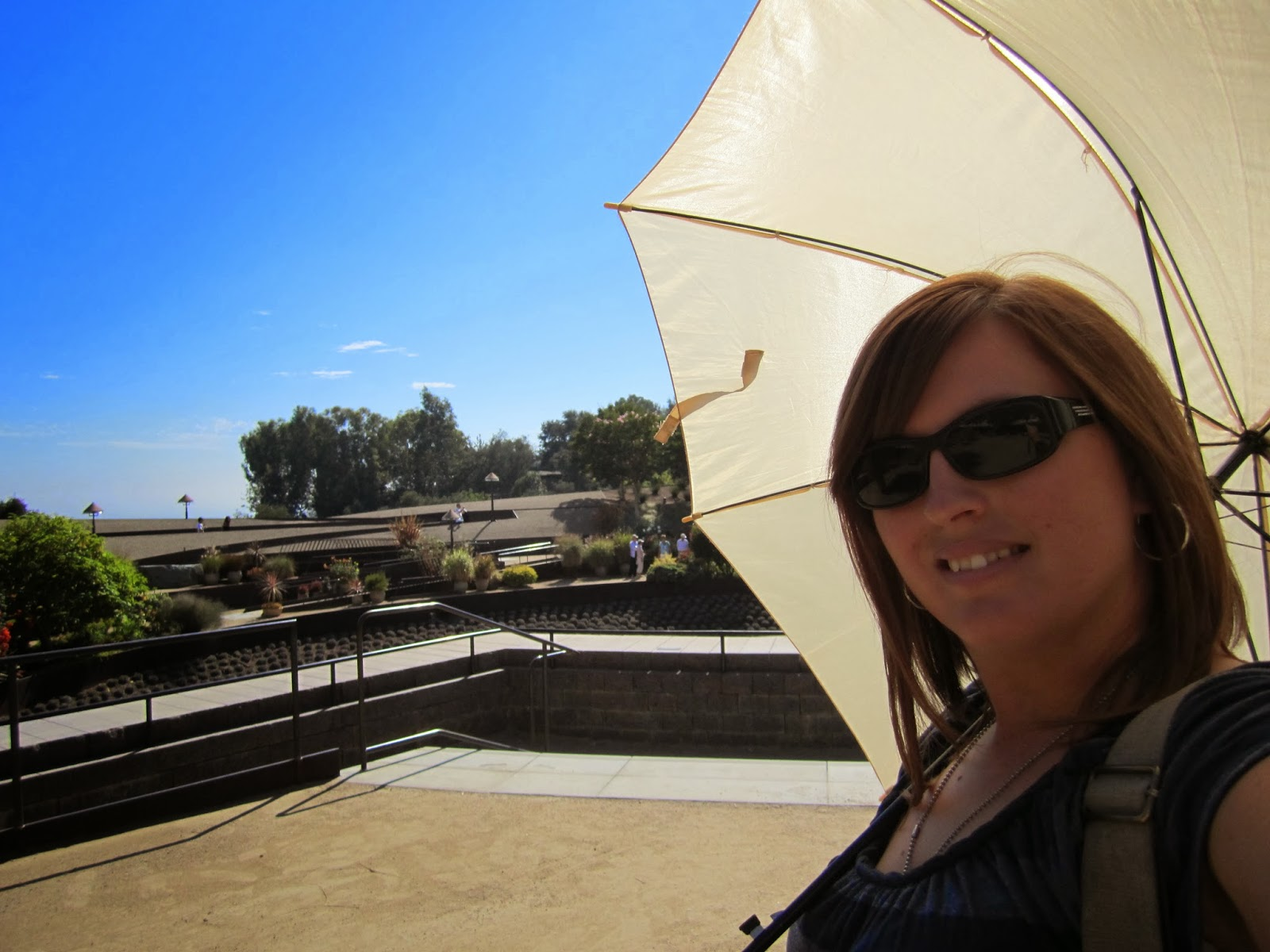 woman with umbrells, sunny, smiling