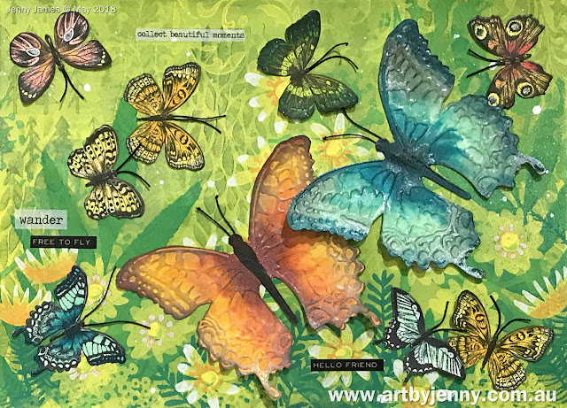 finished flock of butterflies made using stamps, stencils, mermaid markers and paints