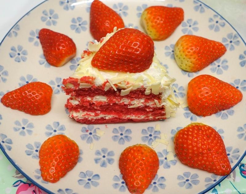 slice of Dudok red velvet cake strawberries decorated