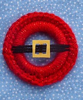 http://www.ravelry.com/patterns/library/santas-jolly-belly---christmas-ring-ornament