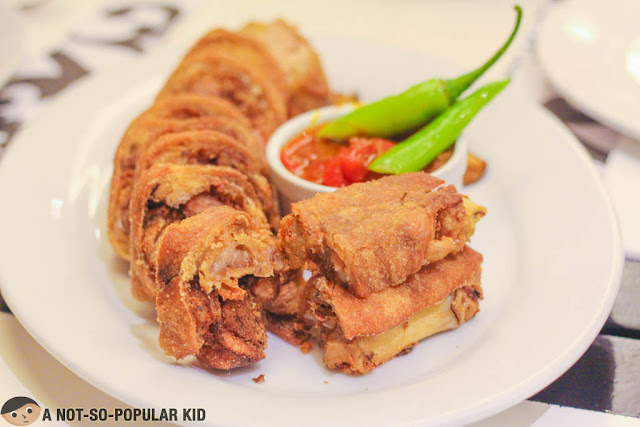 Boneless Crispy Pata Binangoongan of Romulo Cafe