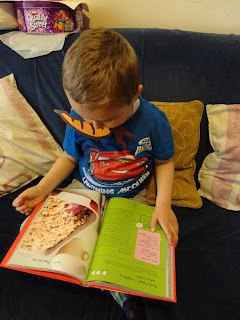 Big Boy looking at Puddings in Ella's Kitchen The Cook Book The Red One