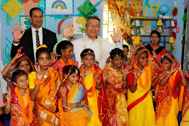 Mr. Kazutada Kobayashi, President & CEO, Canon India brings smiles to young faces at the first anniversary celebrations of its adopted vi