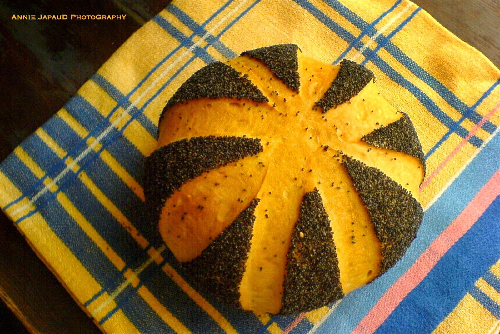 image of a bread covered in poppy seeds