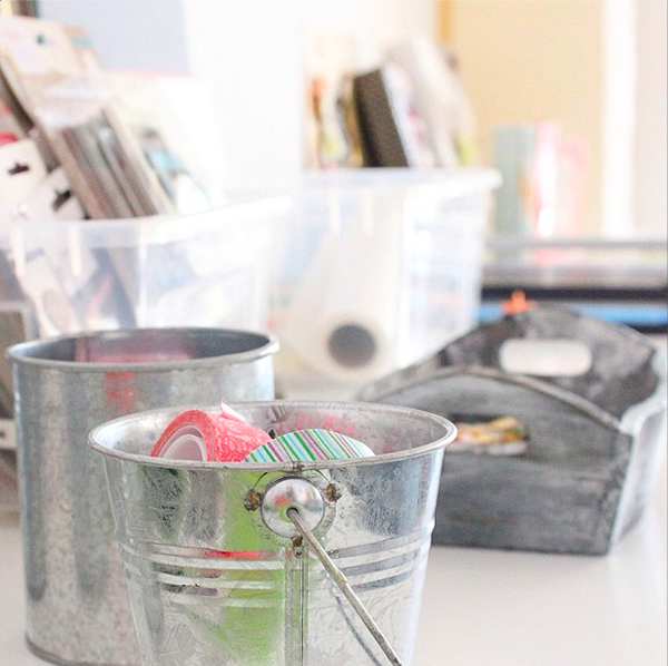 Little Tin buckets and bins used on the desk for scrapbook supplies