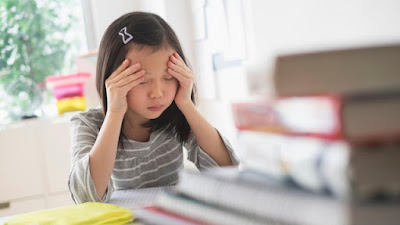 Học sinh Singapore bị trầm cảm dưới áp lực thành tích từ bố mẹ và nhà trường - Ảnh: AFP