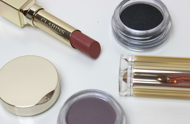 A picture of Clarins Ombre Matte Eyeshadows and Rouge Eclat Lipstick