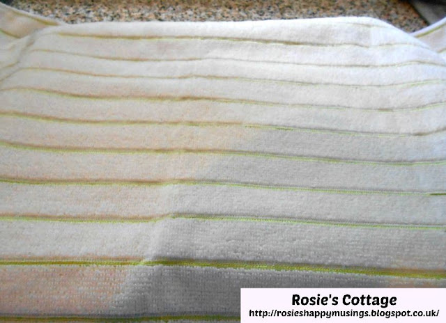 Super Yummy Chocolate Swiss Roll: Cover the baking tray and baking parchment with a clean tea towel.