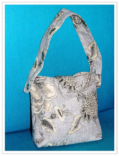 Sytt liten handväska