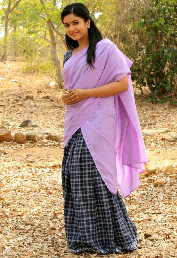 South Indian Chubby Actress Poonam Bajwa Hot Hip Navel In Violet Half Saree