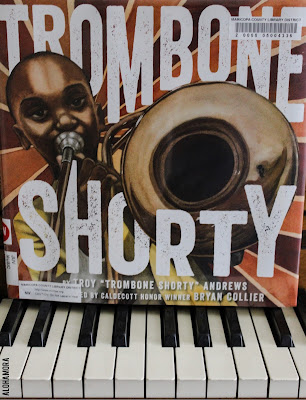 "Trombone Shorty by Troy ""Trombone Shorty"" Andrews and illustrated by Bryan Collier is a fabulous kidlit picture book biography.  This non-fiction autobiography is perfect for elementary school kids studying biography.  It's even more perfect for the music loving kid.  Music teachers, librarians, and class teachers (2nd-6th grade) will love using this great story in lessons.  The pictures are fabulous, and they should be earning the Caldecott Honor . This book gets 4 out of 5 stars in my book review.  Great book, fabulous pictures, writing was good.  The writing could've been a bit more fluid, but it was a great read nonetheless. Alohamora Open a Book www.alohamoraopenabook.blogspot.com east, fast read, research, music, trombone, brass, New Orleans, black history"
