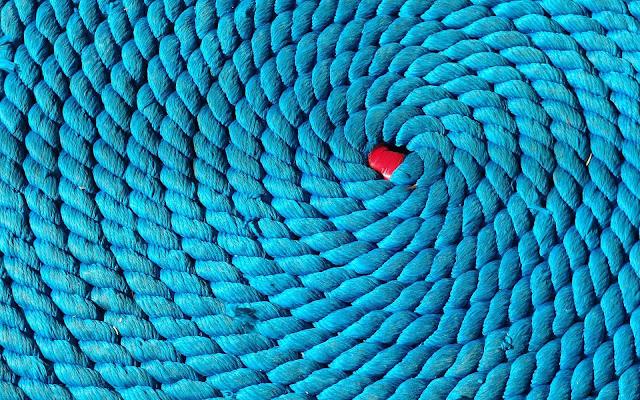 Blauwe achtergrond van touw