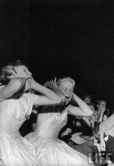 Young girls, screaming fans at an Elivis Jacksonville concert.1950s. Life magazine photo. Pirate Radio and Sealand and Other stories of Rock, Radio, and Regulations. Marchmatron.com