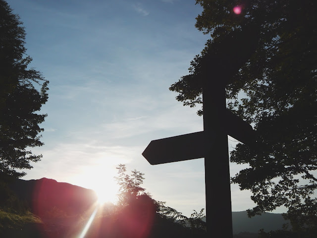 A signpost at sunset at Rydal Water, Lake District, Cumbria
