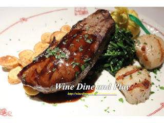Steak with scallops surf and turf dish at the Cape Cod room at the Drake in Chicago
