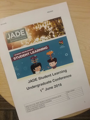 image showing the JADE conference booklet a picture of trees with the two cartoon students below
