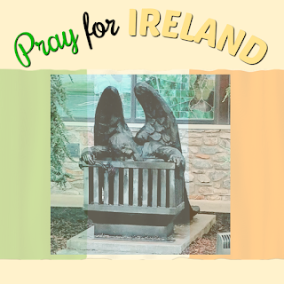 Image of a sculpture of an angel with a rose leaning over an empty crib over an image of the flag for the Republic of Ireland