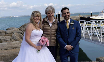 https://www.independent.co.uk/news/uk/politics/theresa-may-wedding-crasher-isle-of-wight-michelle-jason-dight-a8543476.html