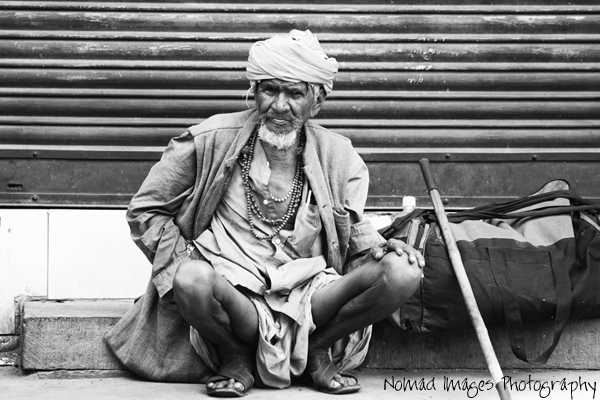 tramp sits destitute on india s city streets
