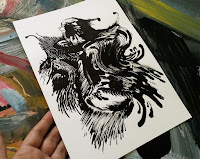 Close up of Kostas Gogas' Drawing entitled Black Rooster. Here, showcasing the artwork's size relevant to a hand. Click to enlarge.