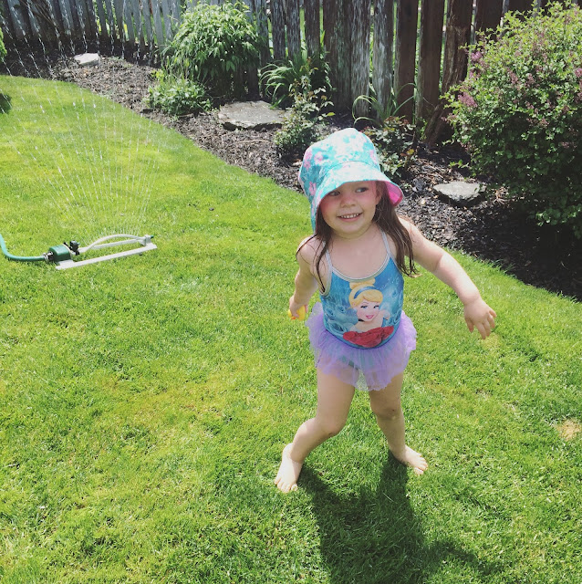 summer - little girl in sprinkler
