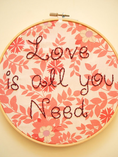 hand embroidered wall art hoop featuring Beatles love is all you need song lyrics on vintage fabric