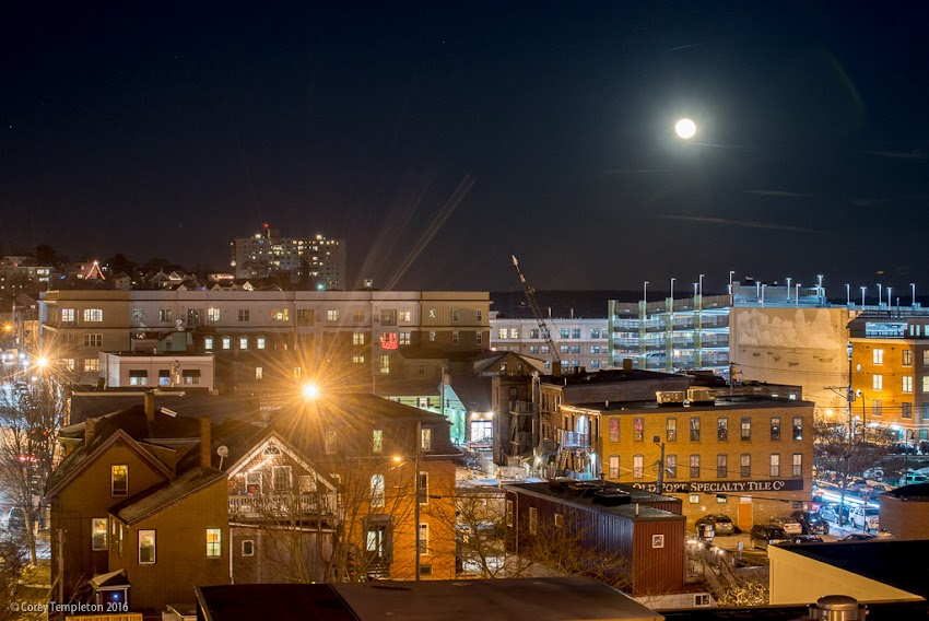 Portland, Maine USA December 2016 photo by Corey Templeton of moon rising above India Street Neighborhood in the winter.