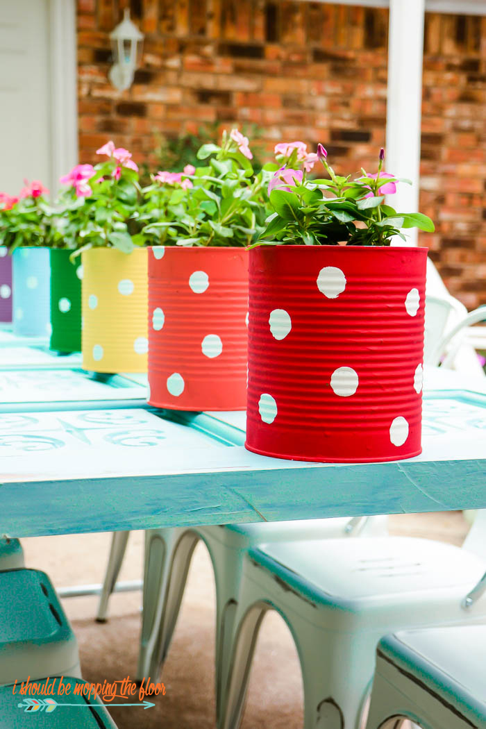 Tin Can Fence Garden | Make a fun garden on your fence...or use these as centerpieces! Fun and easy tutorial that the whole family can help with!