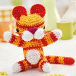 http://www.topcrochetpatterns.com/free-crochet-patterns/amigurumi-tiger-toy