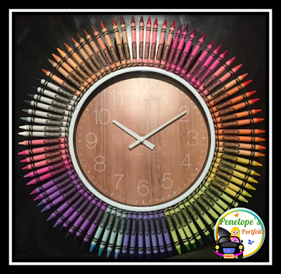 Completed rainbow color pattern crayon clock pictured